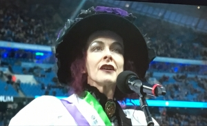 Rosie Garland sings at Etihad Stadium